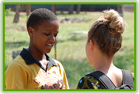 A volunteer in conversation with a student